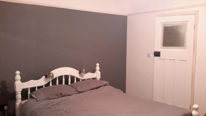 Newly painted white door frame