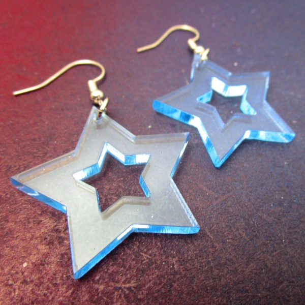 blue acrylic star dangle statement earrings