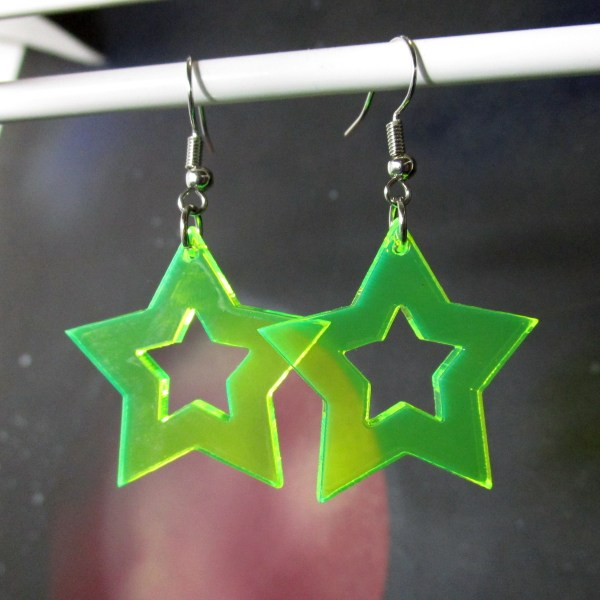 neon green rave star cutout earrings