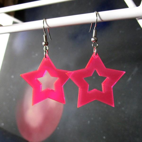 neon pink rave star cutout earrings