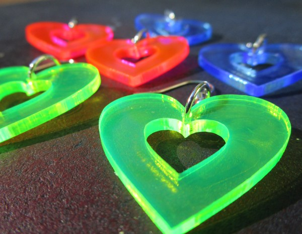 close up of collection of multicolored neon heart earrings