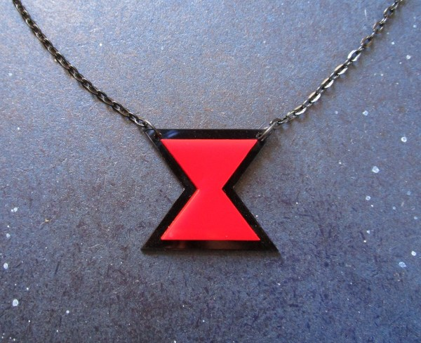 front view of black widow necklace hourglass shape with black chain on space background