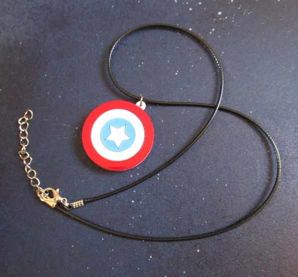 Full view of Captain America Shield Necklace pendant on black cord necklace