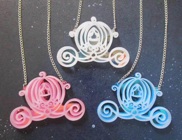Big Cinderella Pumpkin Carriage Necklaces one each of pink blue and silver on space background
