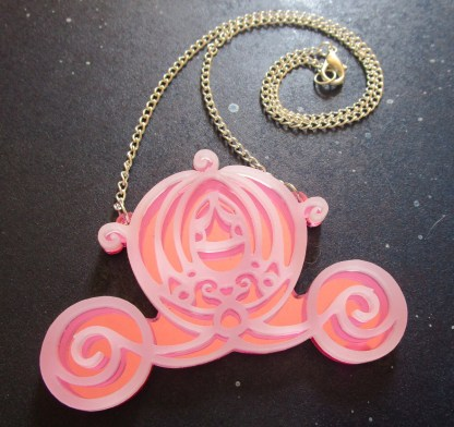 pink Big Cinderella Pumpkin Carriage Necklace with chain in spiral on space background