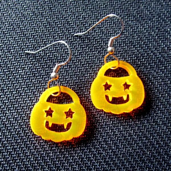 close up of halloween pumpkin earrings with stainless steel earring hooks