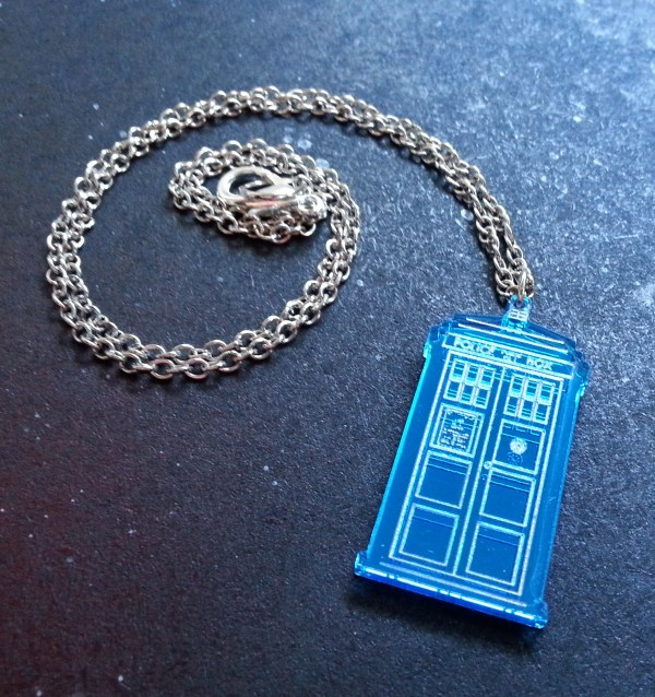 Doctor Who Police box pendant necklace with silver chain in coil to show lobster claw clasp