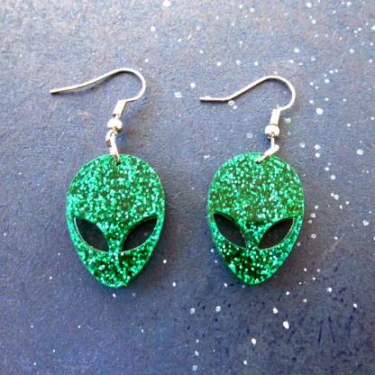 Green Alien Earrings on space background