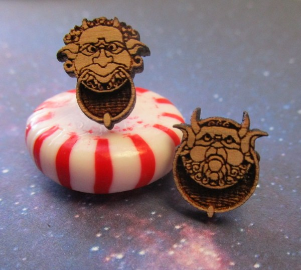 Wooden Labyrinth Door Knocker Stud Earrings on top of red and white candy mint