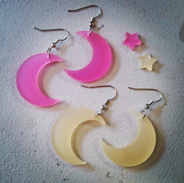 pink moon and light yellow moon dangle earrings on white background