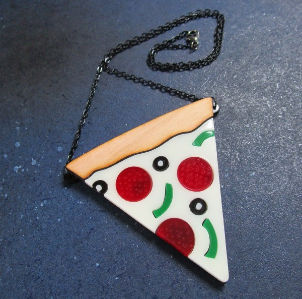 far shot of Pizza Slice Statement Necklace to show black chain and lobster claw clasp