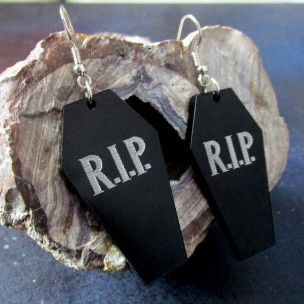 rip coffin dangle earrings on geode rock