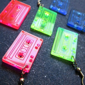 close up of neon tape cassette earrings, 2 pink earrings, 2 green earrings, 2 blue earrings