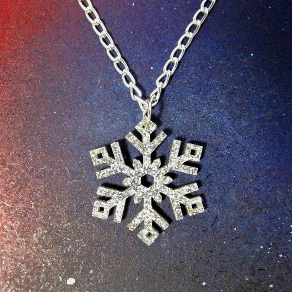 large silver glitter pendant necklace on space background