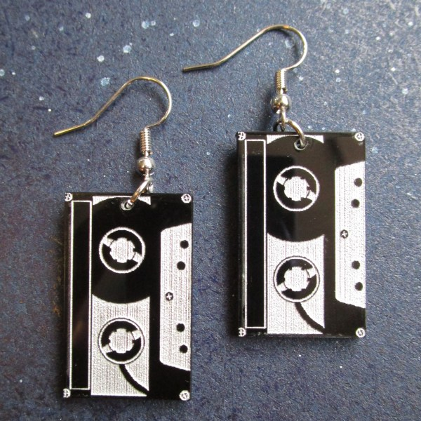 top down view of 90s 80s tape cassete retro earrings