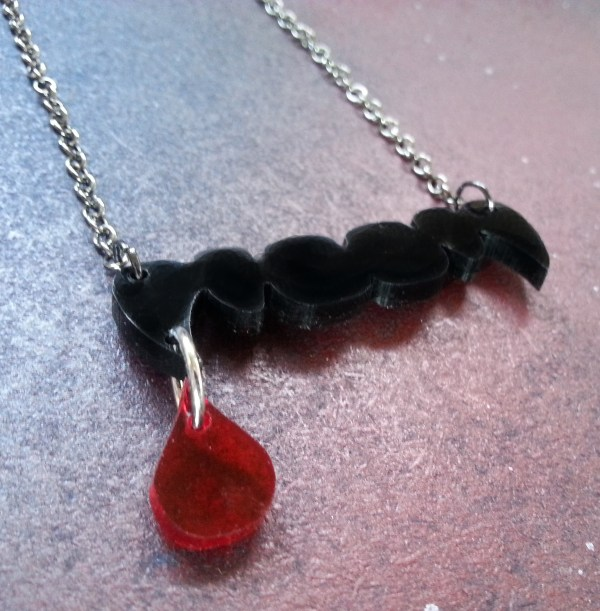 black vampire fang teeth with hanging blood drip pendant necklace