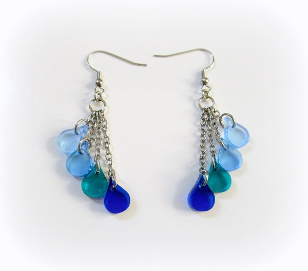 blue drop dangle earrings fanned out ver white background