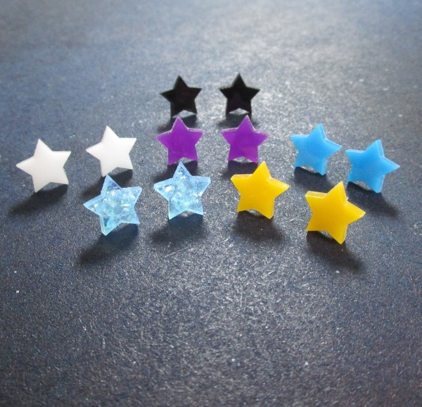 collection of small star stud earrings in multiple colors