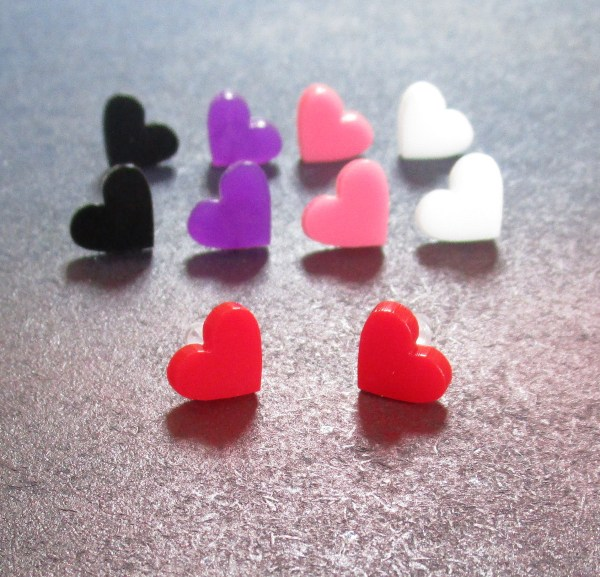 collection of small heart stud earrings in multiple colors