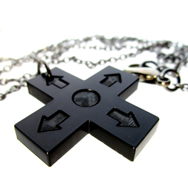 close up of controller d pad pendant on white background