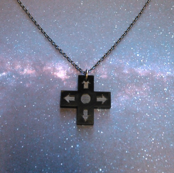 blace controller direction pad necklace on space background