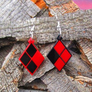 harley quin dangle earrings on wood