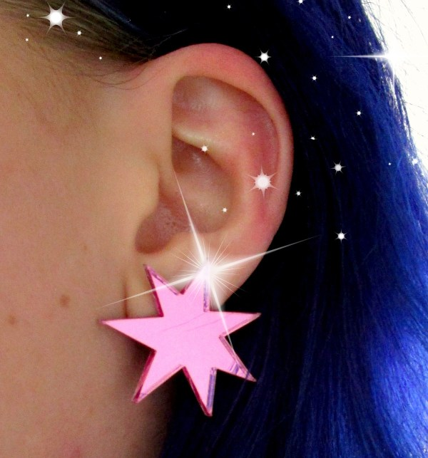 Jem and the Holograms pink cosplay earring on ear and sparkles