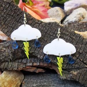 lightning rain clouds dangle earrings on bark background