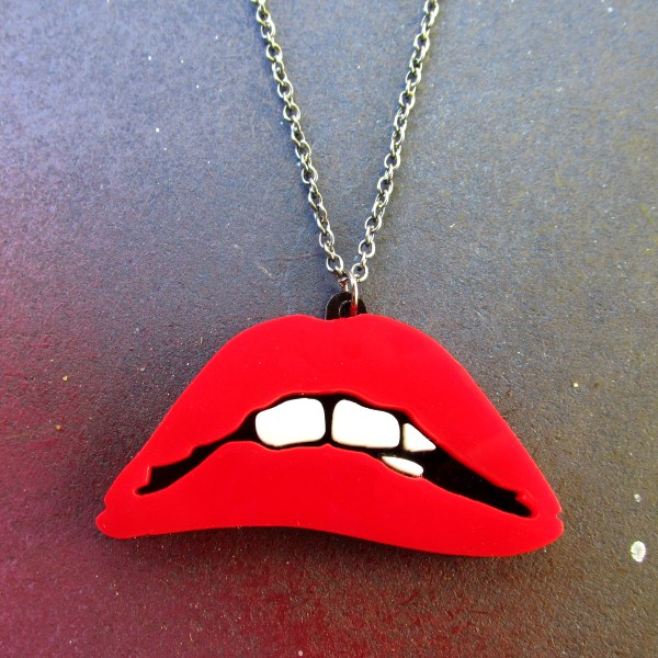 red lips with white teeth biting lip pendant necklace