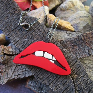 rocky horror picture show red singing lips on bark background