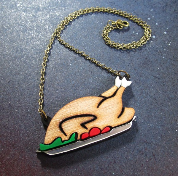 side view of turkey dinner on platter shaped necklace with chain