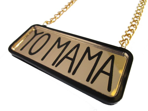 close up of yo mama text pendant on gold chain with white background hanging sideways
