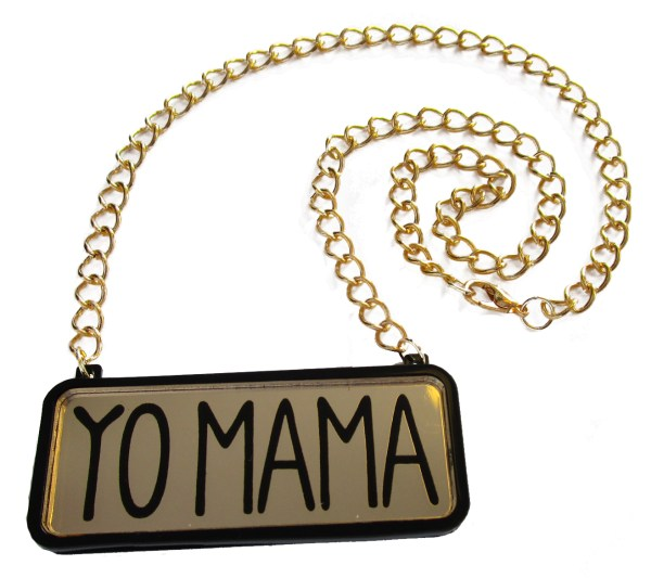 gold yo mama statement necklace with gold chain in coil to show lobster claw clasp