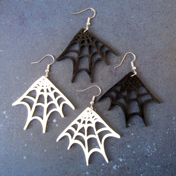 black and white color spider web dangle earrings on space background