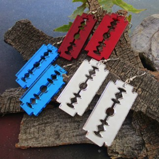 silver blue and red double sided razor blade earrings on wood