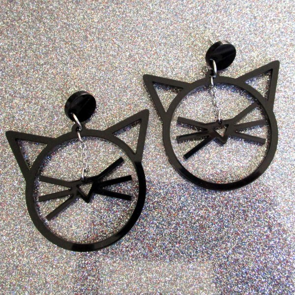 black whisker and cat face ears shape earrings on glitter background