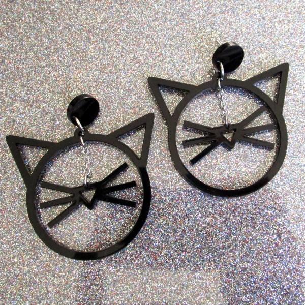 black whisker and cat face ears shape earrings on glitter background