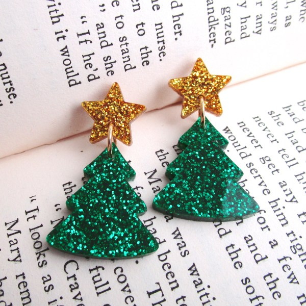 green xmas tree earrings on book