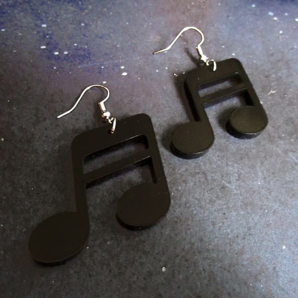 close up of musical note shaped earrings
