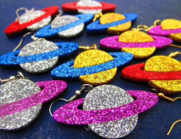 collection of glitter planet saturn dangle earrings glitter