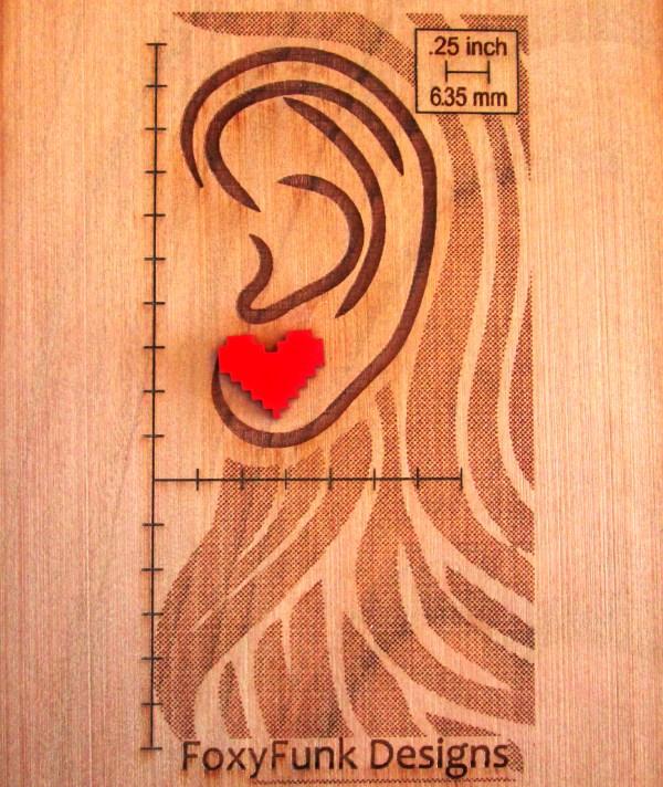 red pixel heart on board showing size foxyfunk designs logo on wood