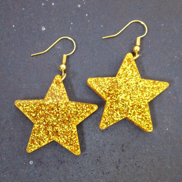 big gold glitter dangle star earrings