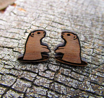 groundhog coming out of a hole shaped wood earrings on wood