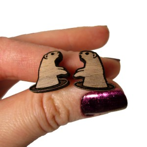 hand holding groundhogs day wood stud earrings