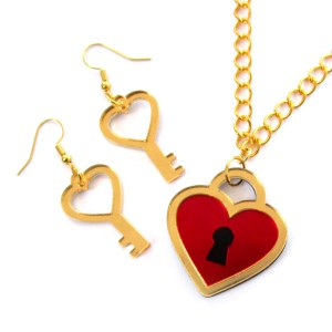 up close look at gold and red heart lock necklace and heart key earrings jewelry set