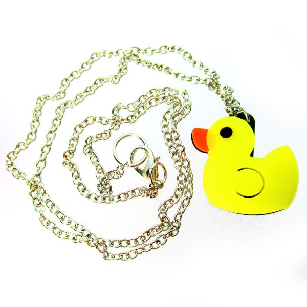 yellow duck pendant necklace and chain in a spiral to show detail
