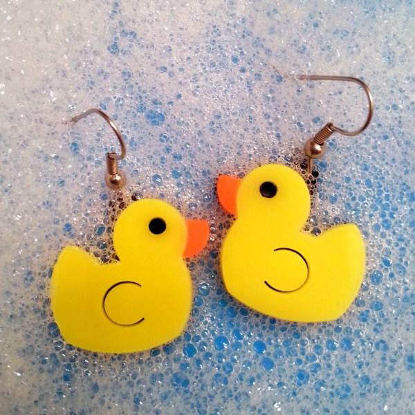 yellow rubber duck earring in bubbles
