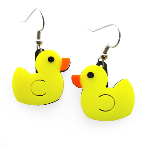 close up detail of yellow rubber duck earrings