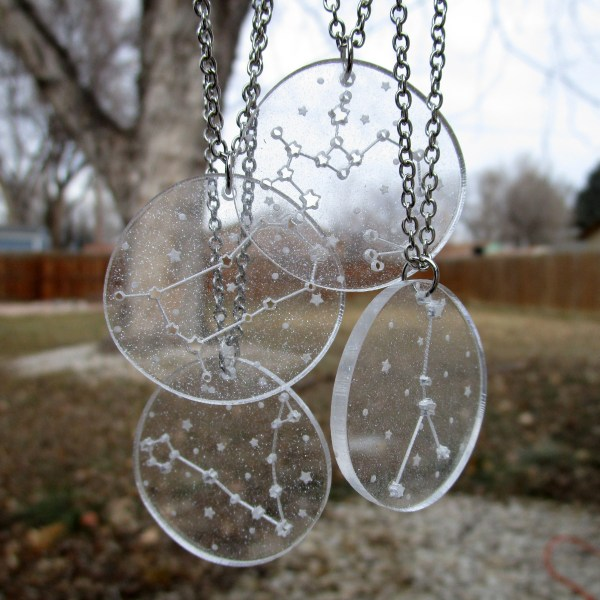 4 hanging zodiac sign constellation star pendant necklaces with back yard in background