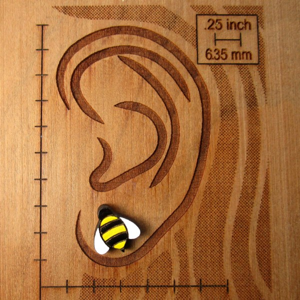 bee earring on ear board to show size